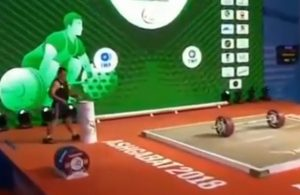230 for Iran's Sohrab Moradi to earn the clean jerk and total world records